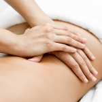 Lower back pain being treated gently through physio