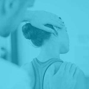 Woman receiving treatment for neck pain from a physiotherapist